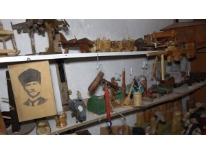 25 yıldır ahşaba şekil veriyor: Binin üzerindeki eseri garajında sergiliyor