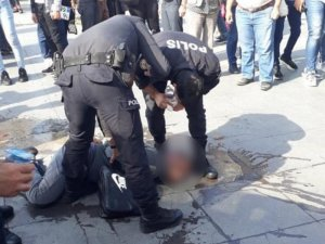 ATM gaspçısı, polise kafa atıp dudağını patlattı