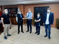 İl Sağlık Müdürü Daharlı'ya Pandemiyle Mücadele Kapsamında Başarı Ödülü Verildi